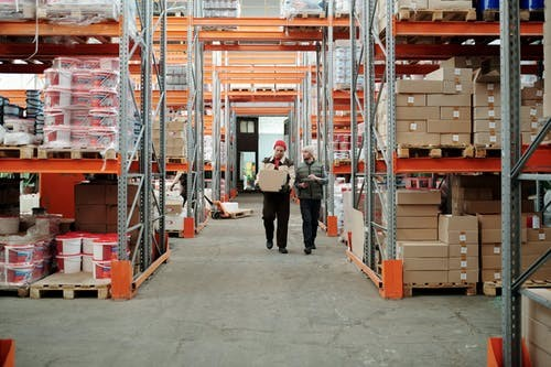 men in a warehouse discussing inventory
