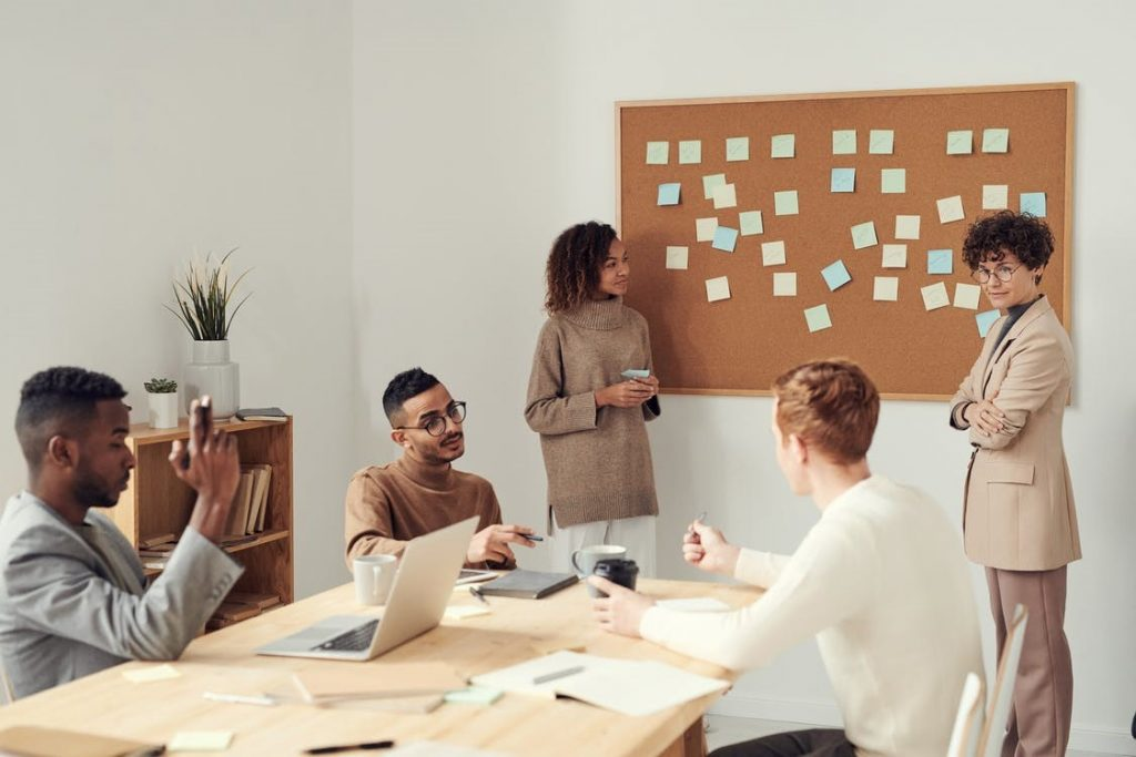 people engaging in a discussion in a business meeting.