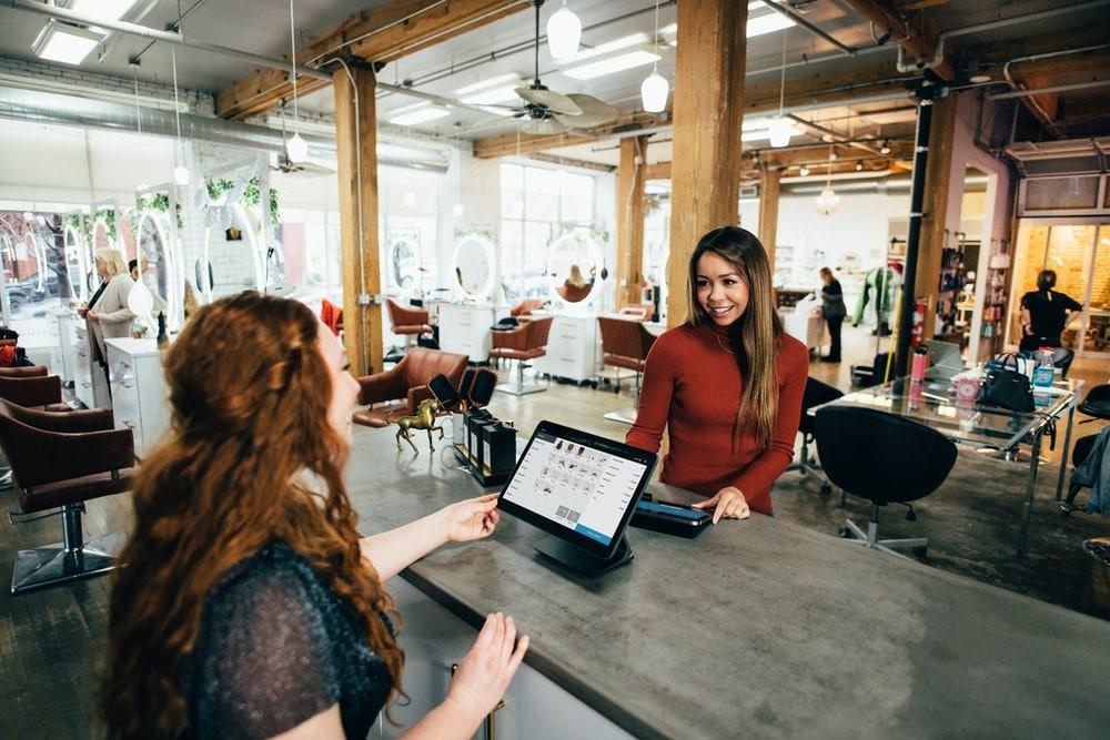 woman-talking-salesperson